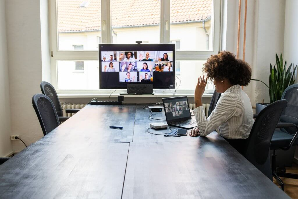 student at the computer joining a virtual team meeting